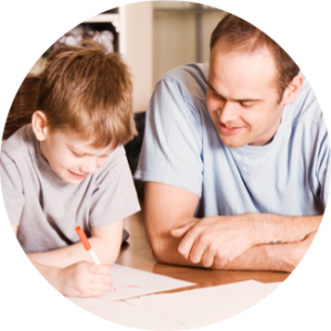 Dad helping his son with his homework