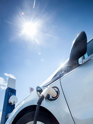 Electric vehicle charging with bright sun overhead