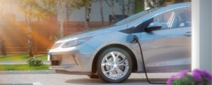 Electric vehicle connected to a charger