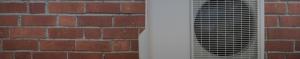 Heat pump on a brick wall