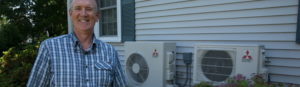Man standing next to his new heat pumps