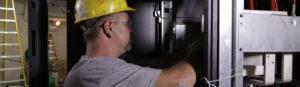 Man working on an uninterruptible power supply
